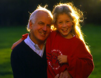 Grandfather and granddaughter posing for picture